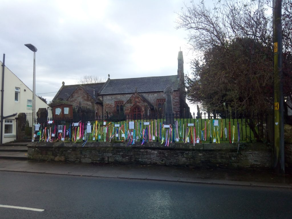 Church with ribbons on Loudfence